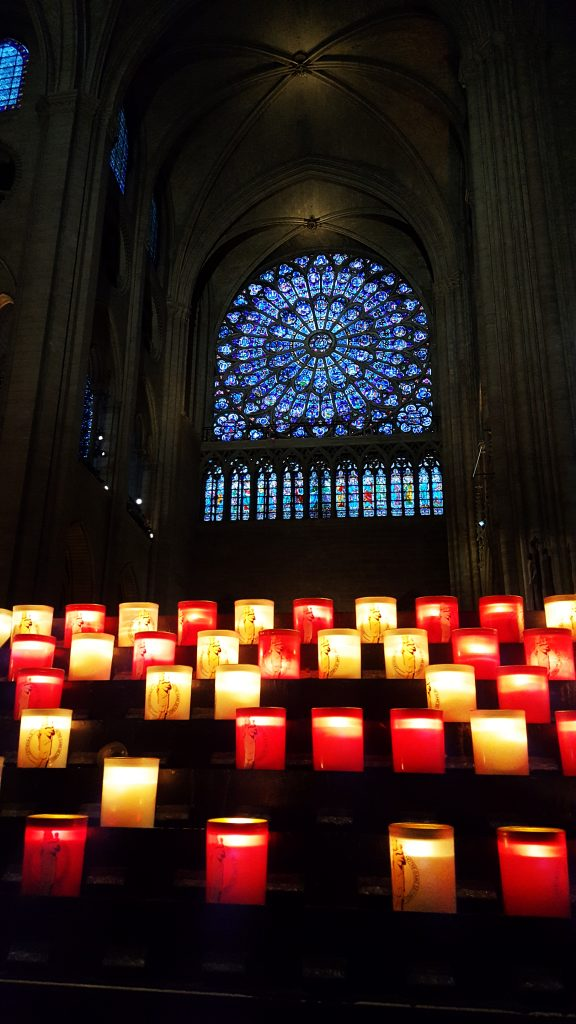 Votive candles inside of Notre Dame cathedral in Paris, France