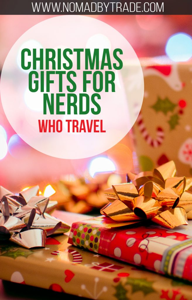 """Wrapped Christmas presents with text overlay reading """"Christmas gifts for nerds who travel"""""""