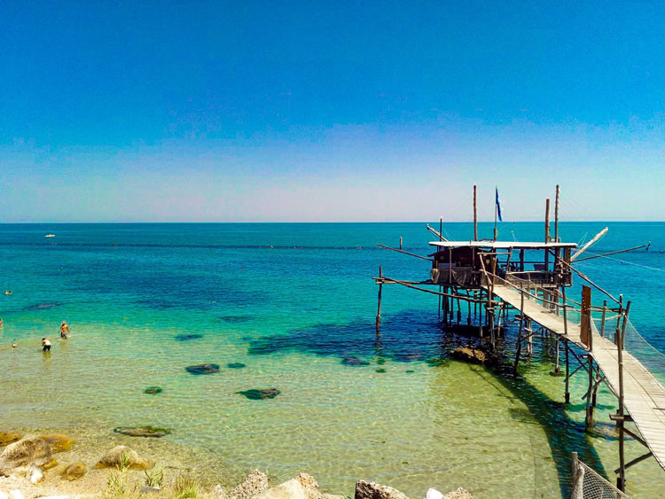 Traboccho extending over clear waters on the Costa de Trabocchi