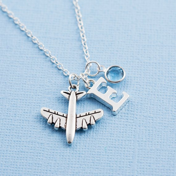 Necklace with airplane charm, initial, and birthstone