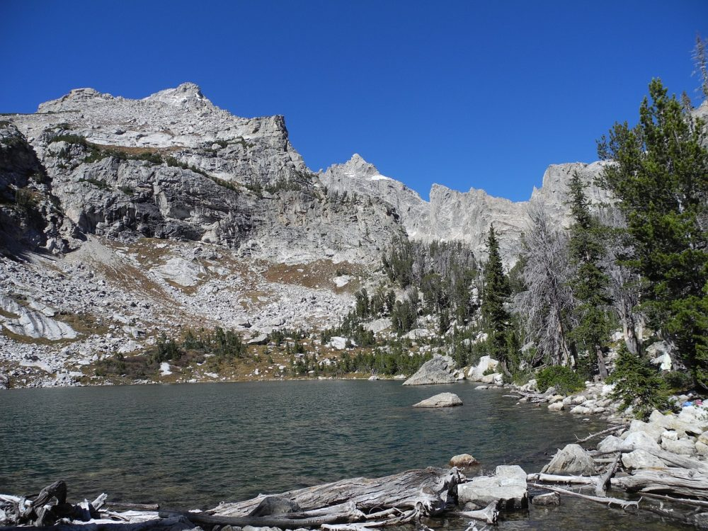 Photo of Amphitheater Lake, a small mountain lake surrounded by rocky peaks at the end of one of the best Grand Teton hikes