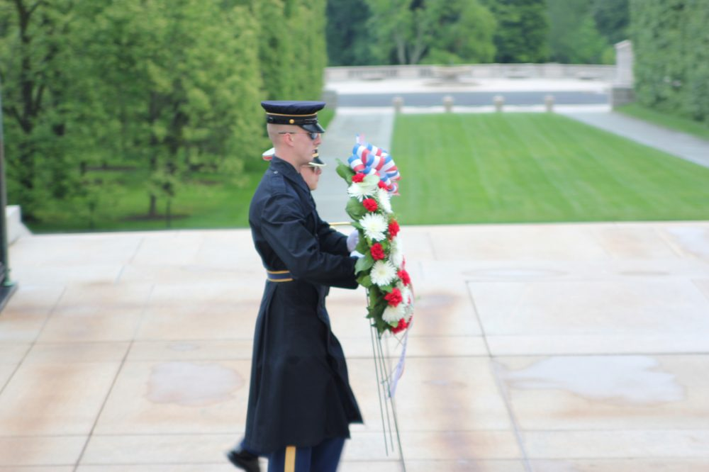 Solders with a wreath during the changing of the guard at the Tomb of the Unknown Soldier