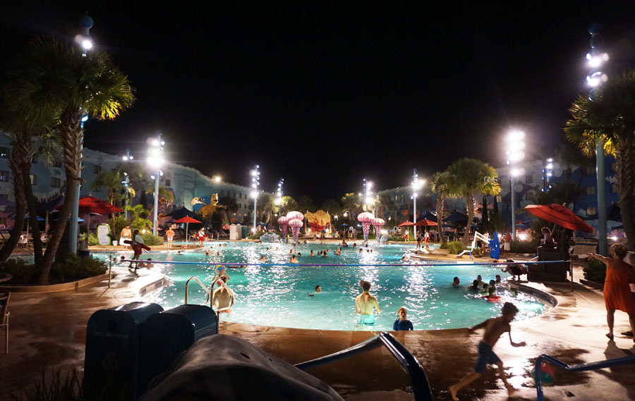 Night time at the main Art of Animation pool