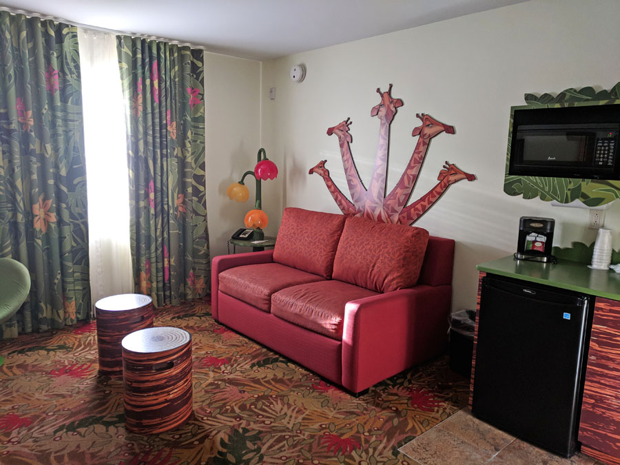 Disney's Art of Animation Lion King Suite with pull-out couch with giraffe detail and a kitchenette