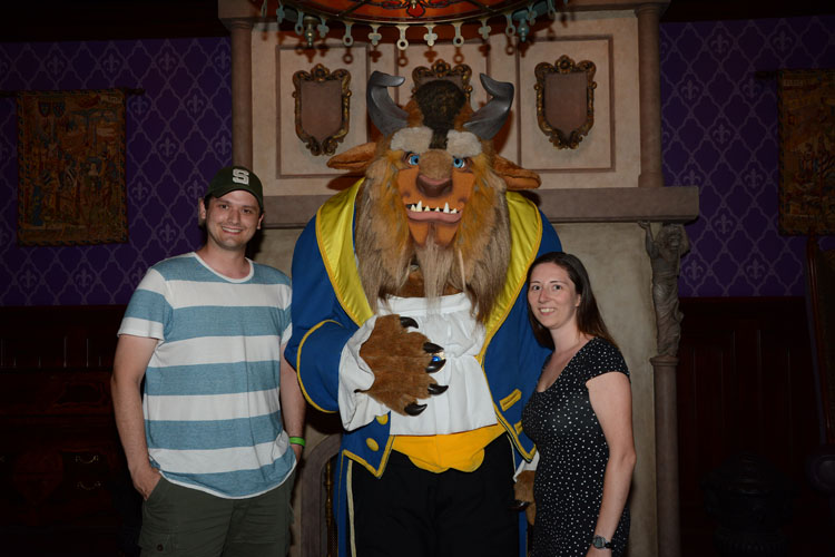 Couple posing with The Beast at Be Our Guest restaurant in the Magic Kingdom