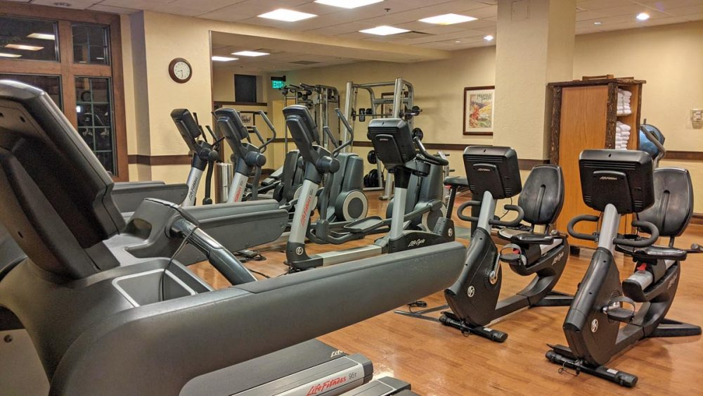 Rows of treadmills and other exercise equipment at the Wilderness Lodge gym