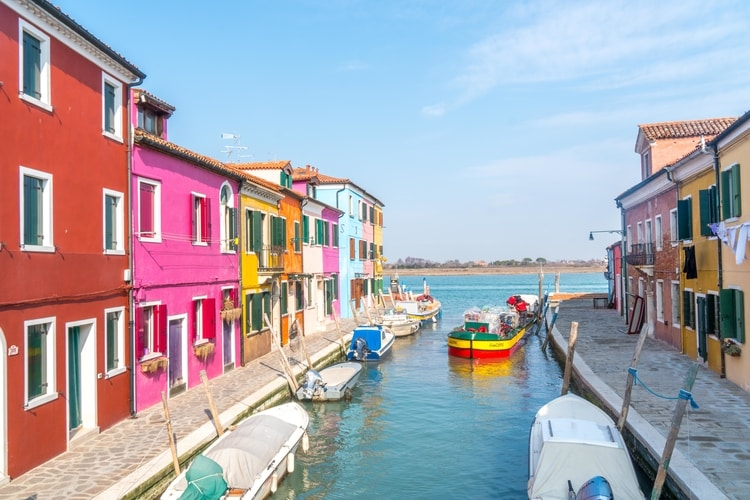Colorful houses along the water in Burano