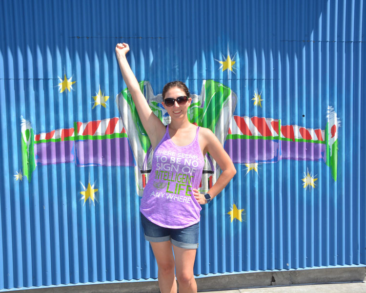 Woman posing in front of Buzz Lightyear wings at California Adventure