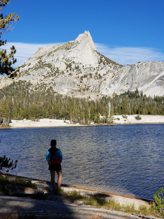 Hiker posing along the Cathedral Lakes Trail in Yosemite