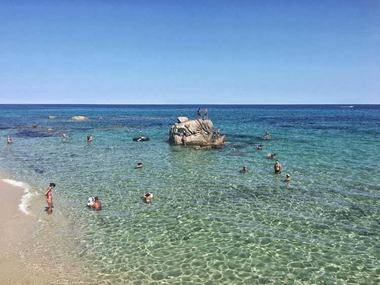 Swimmers in the turquoise waters of Costa Rei