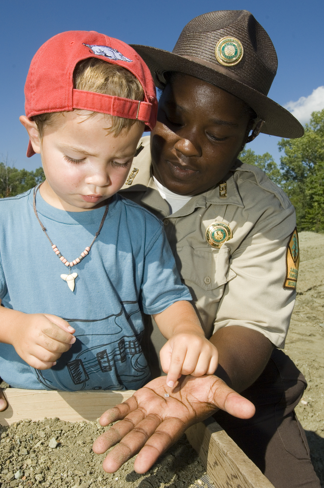 Park ranger and boy hunting for diamonds at Crater of Diamonds State Park