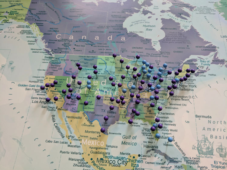 Closeup of North America covered with push pins