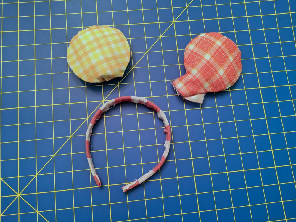 Ears laid out to assemble a homemade Minnie Mouse ear headband