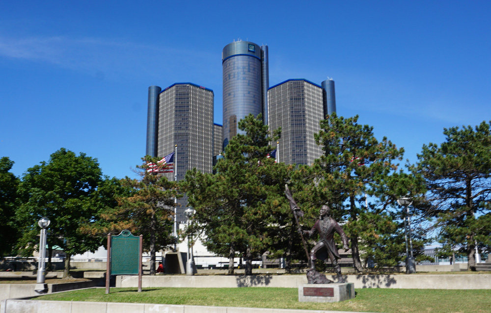 Large skyscraper with trees in the foreground