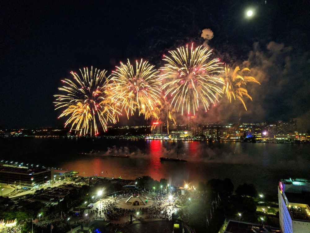 Fireworks over a river