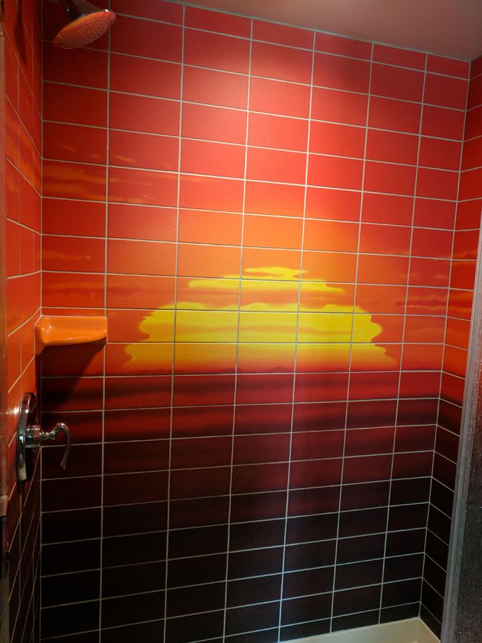 Sunrise colored tile in the Art of Animation Lion King Suite bathroom