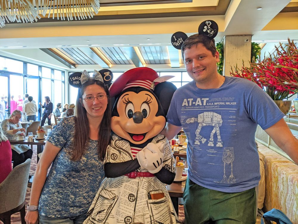 Couple posing with Minnie at Topolino's Terrace