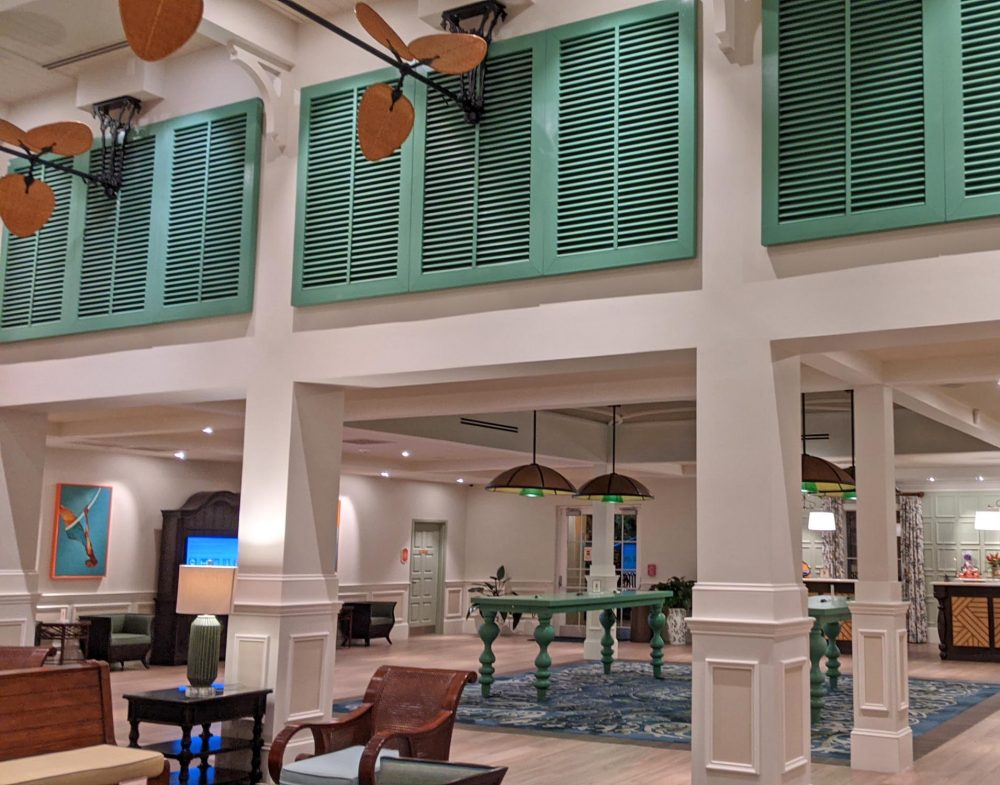High ceilinged lobby with fans and chairs at Disney's Caribbean Beach Resort