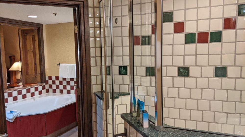 Shower, jacuzzi, and connecting doors