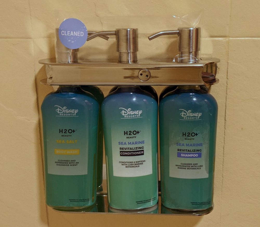 Bottles of soap, shampoo, and conditioner mounted in the shower at Disney's Caribbean Beach Resort