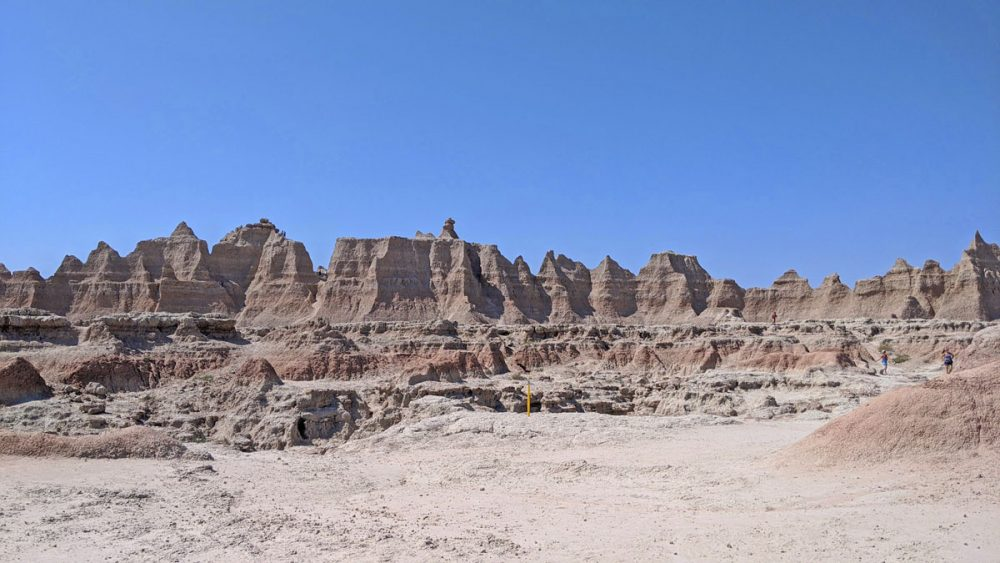 Trail marker and rock formations along the Door Trail in Badlands National Park
