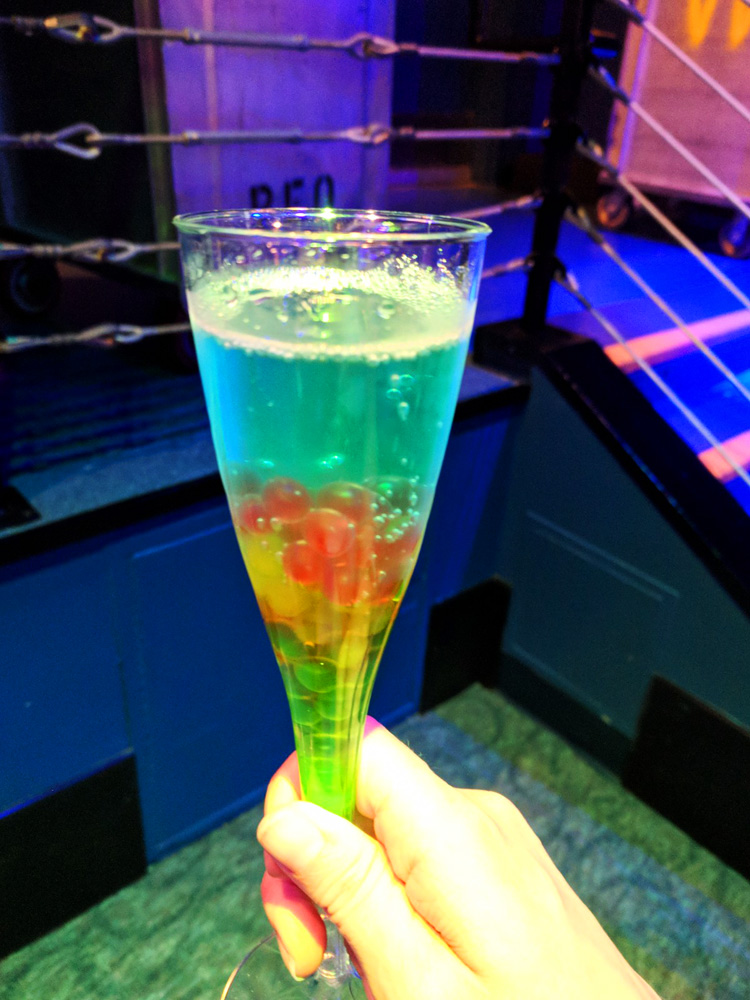 Champagne flute with rainbow colored boba pearls from the Epcot International Food and Wine Festival drink menu