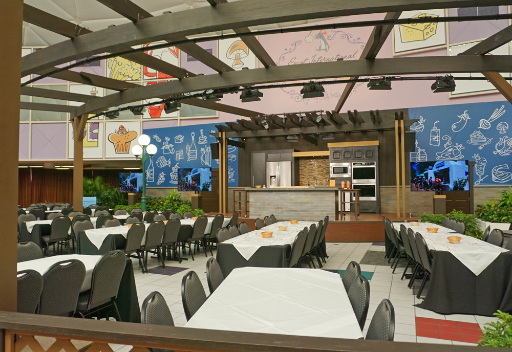 Stage for Food and Wine culinary demonstrations with empty tables for guests
