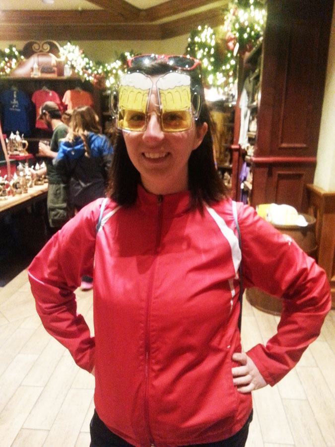 Woman wearing beer sunglasses at a Disney World New Year's Eve party