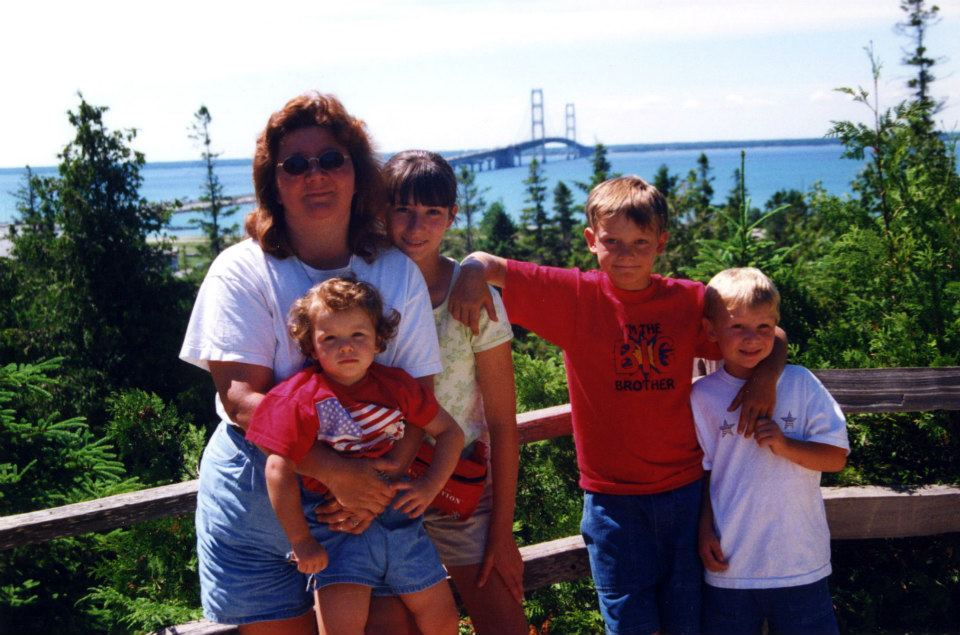 Woman and kids in front of the Mackinac Bridge