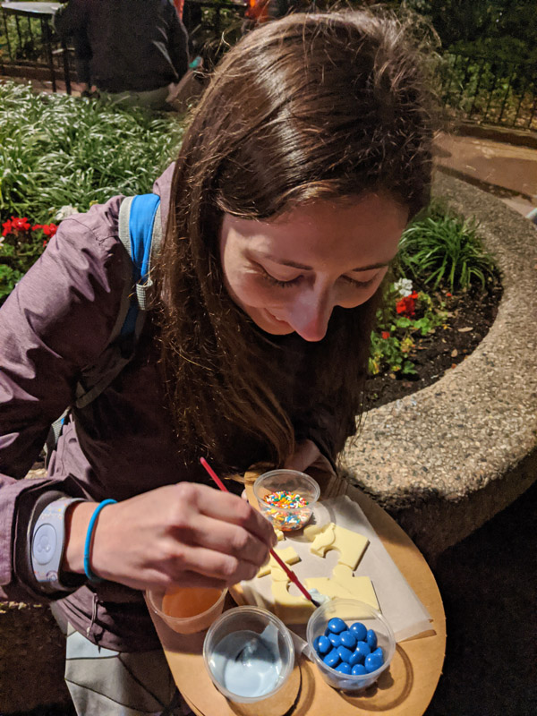 Woman decorating a Figment chocolate puzzle at the Festival of the Arts