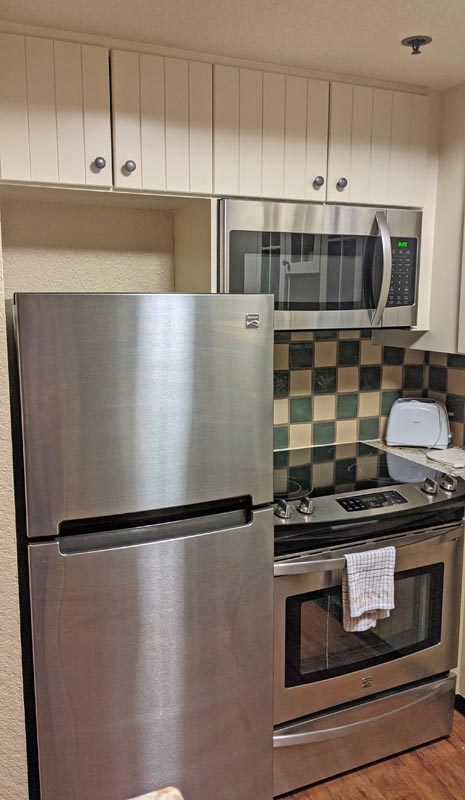 Stainless steel refrigerator, stove, and microwave  in the Boulder Ridge villa kitchen