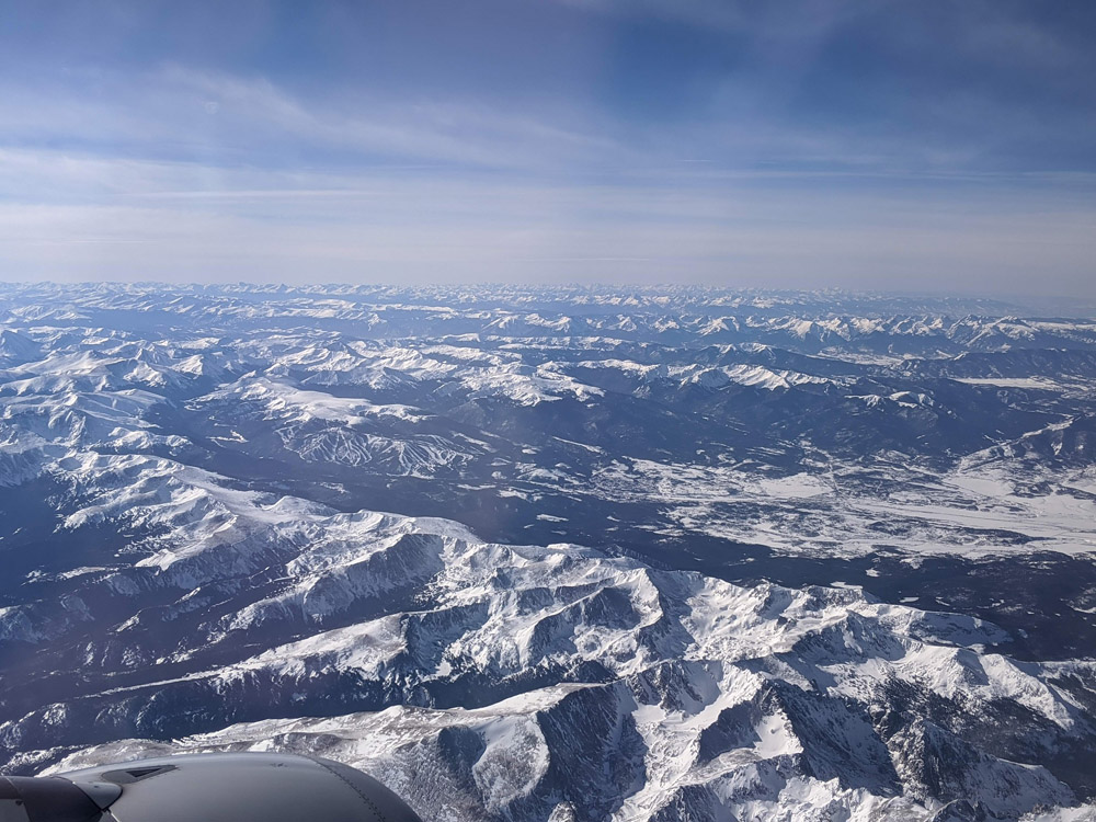 Aerial view of the Rocky Mountains approaching the Vail airport