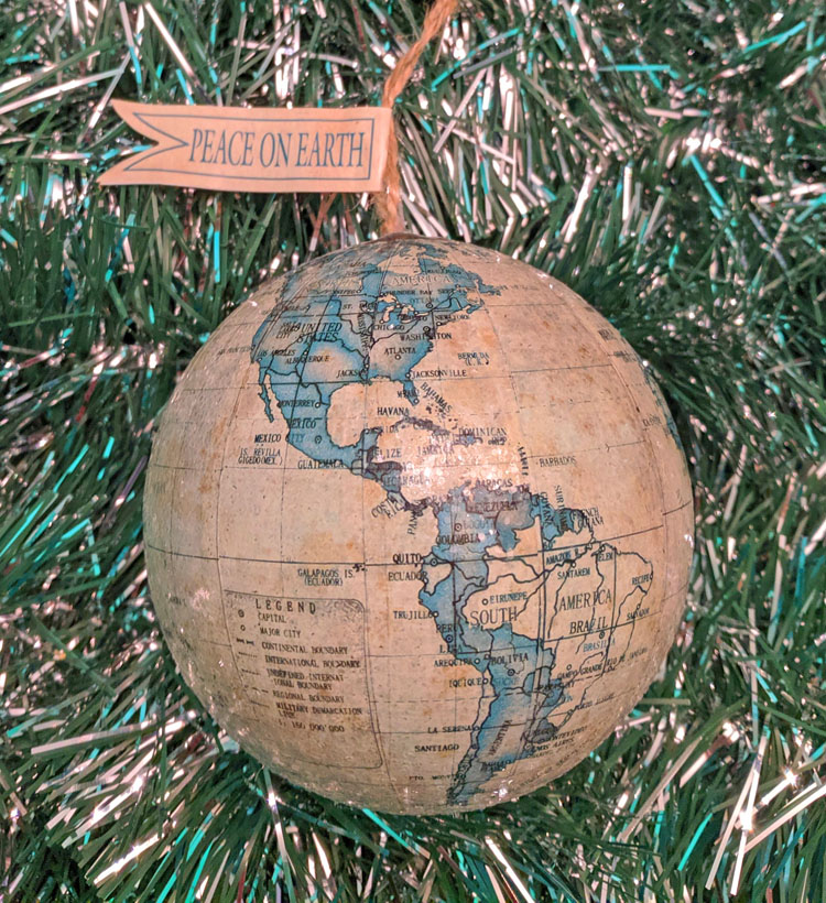 """Globe travel ornament with flag saying """"peace on earth"""""""