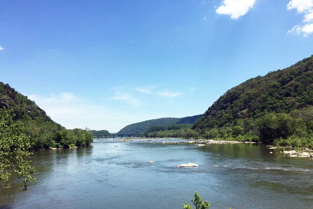 Wide river between rolling mountains at Harpers Ferry, West Virginia