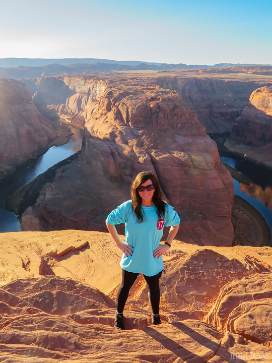 Woman standing in front of Horseshoe Bend