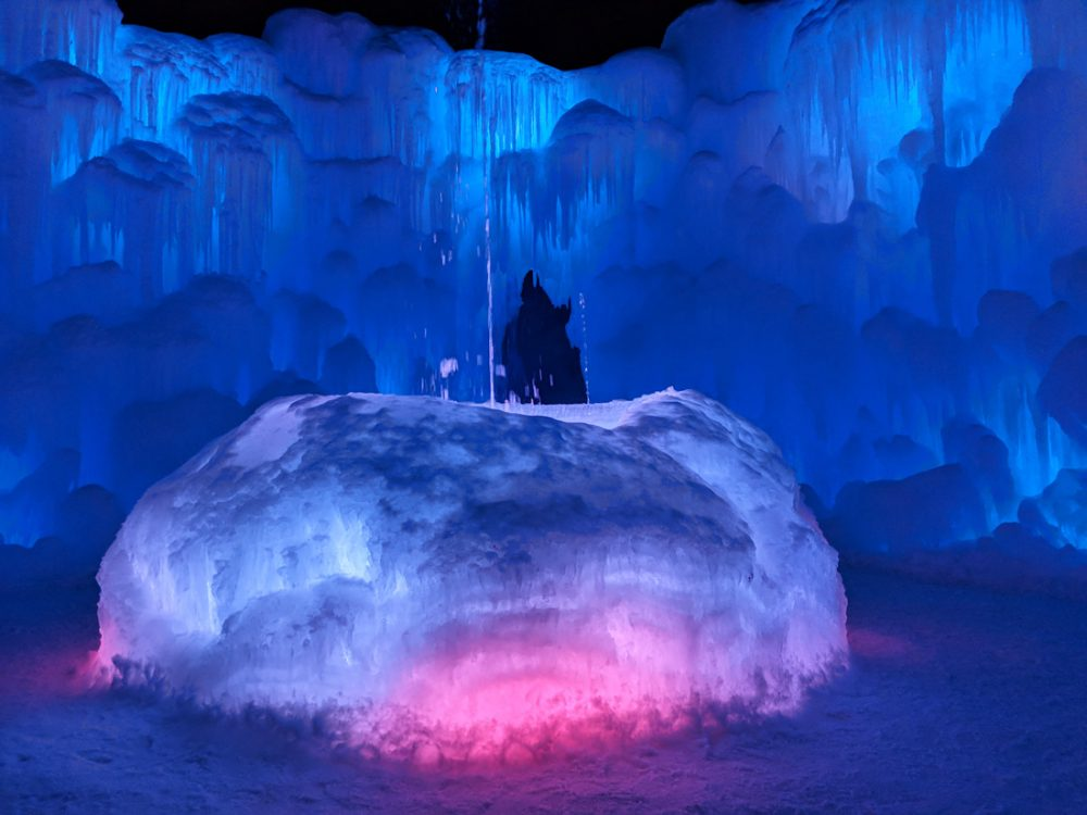 Brightly lit ice castle in Lincoln, New Hampshire