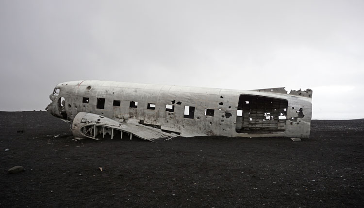 Plane wreckage on a black sand beach in Iceland