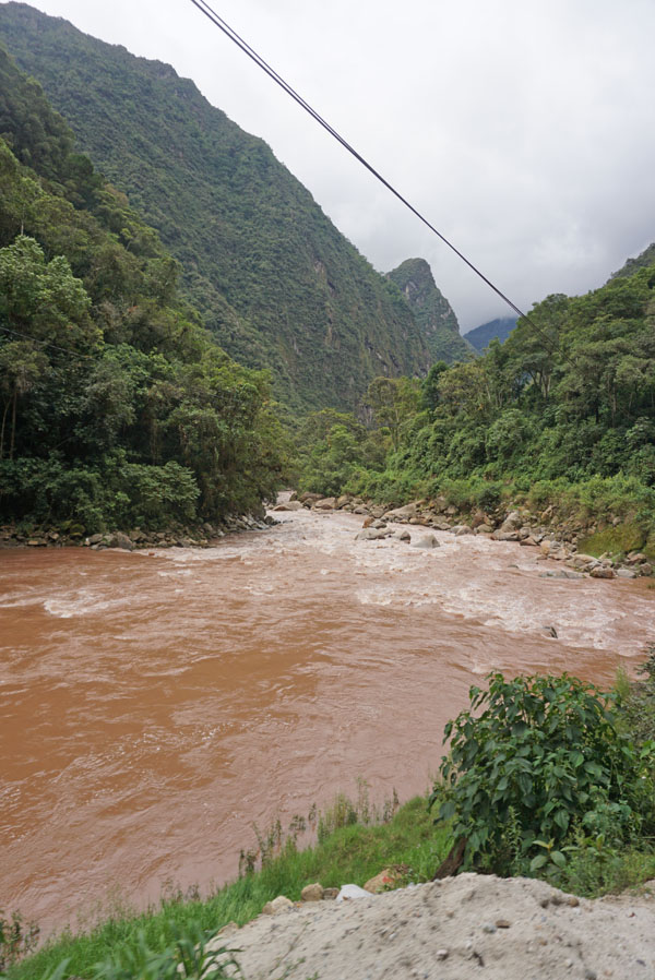You'll get the same stunning views of the Urubamba river running between mountains whether you ride Inca Rail or Peru Rail