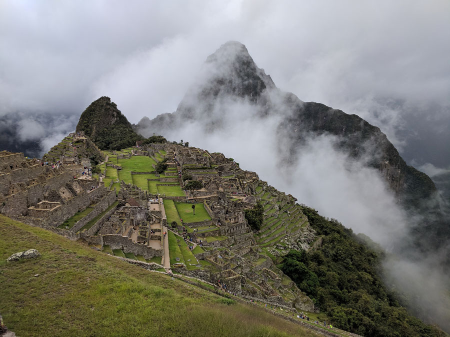 Machu Picchu buildings with clouds obscuring the mountains