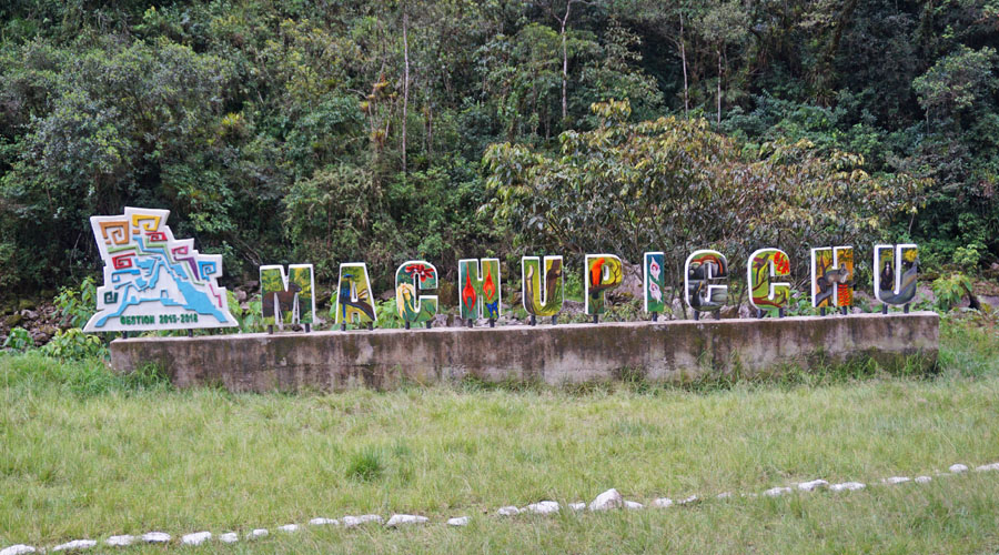 """Colorful sign reading """"Machu Picchu"""" along the train to Aguas Calientes"""