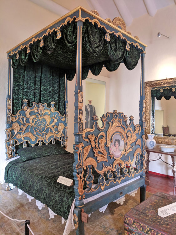 Ornate bedframe on display in the Museo Historico Regional in Cusco