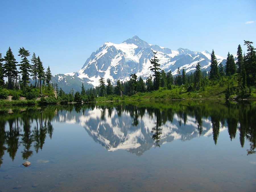 Mountain peak reflected in a lake in North Cascades National Park