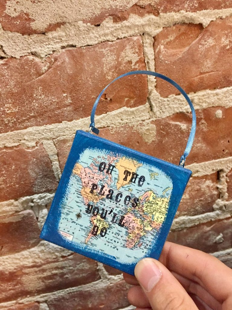 """Map ornament with text reading """"Oh the places you'll go"""""""