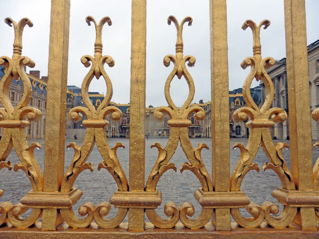 Golden gates at the Palace of Versailles - how to get to Versailles