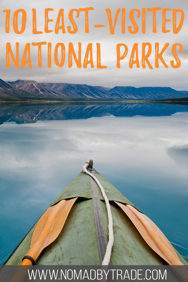 """Kayak in Lake Clark National Park with text overlay reading """"10 least-visited national parks"""""""