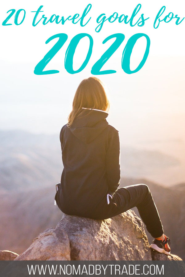 """Woman sitting atop a mountain with text overlay reading 20 travel goals for 2020"""""""