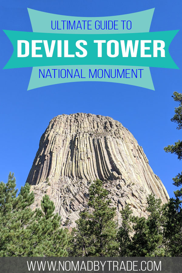 """Photo of Devils Tower with text overlay reading """"Ultimate Guide to Devils Tower National Monument"""""""
