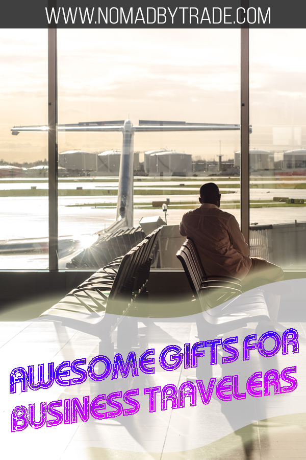 """Business traveler waiting for a flight with text overlay reading """"awesome gifts for business travelers"""""""