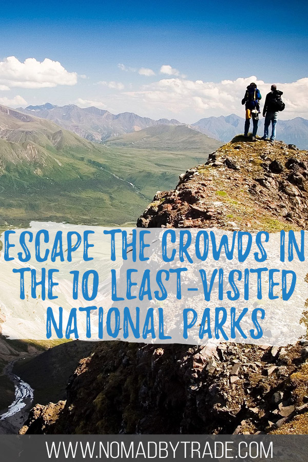 """Hikers in Wrangell-St. Elias National Park with text overlay reading """"Escape the crowds in the 10 least-visited national parks"""""""
