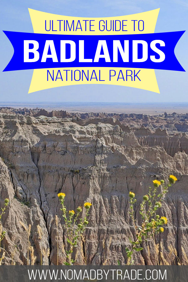 "Photo of rock formations and flowers at Badlands National Park with text overlay reading ""ultimate guide to Badlands National Park"""